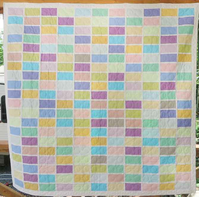 City Sweets, pattern taken from the book City Quilts by Cherri House, is a good example of how grid lines can add interest to a quilt.