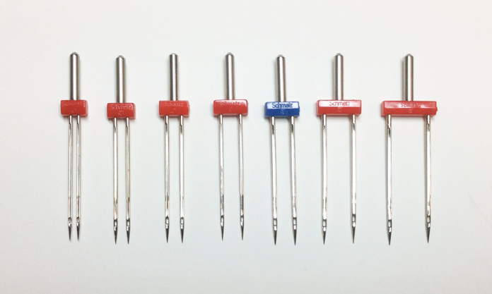 A variety of SCHMETZ twin needles appropriate to quilting