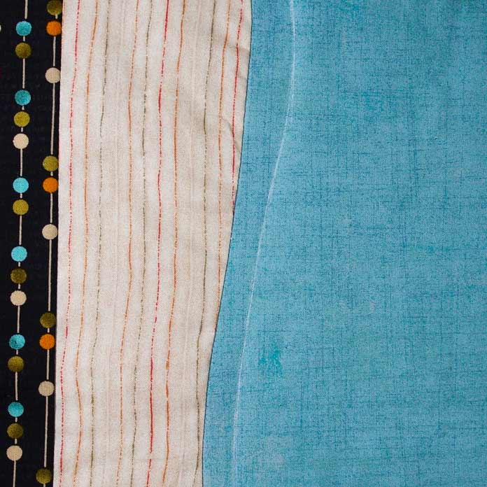 Chalk line echoing curved seam for quilting line