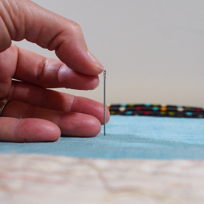 Self-threading needles have a notch on the top for easy threading