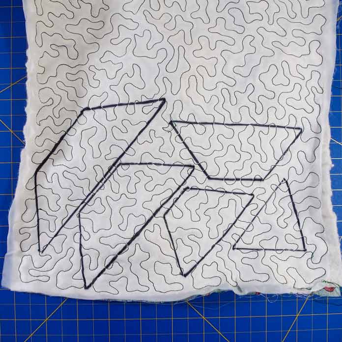Tree shapes drawn on back of textured fabric