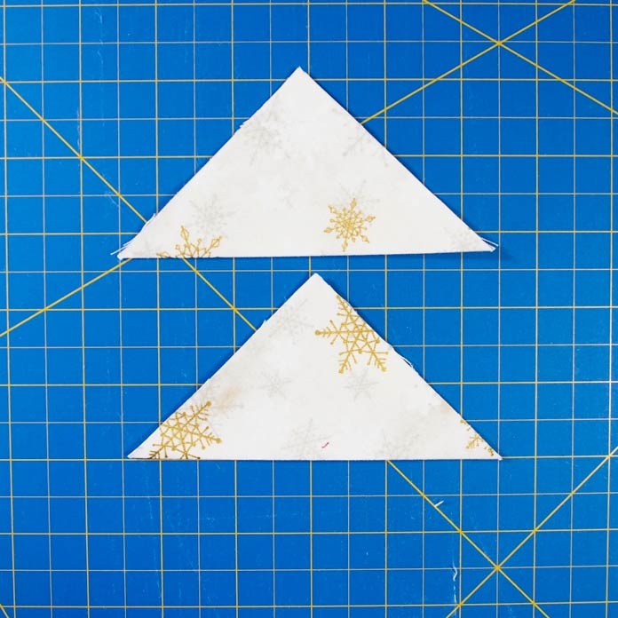Squares folded into triangles