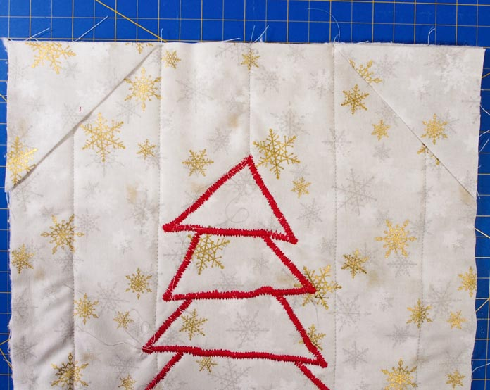 Corner triangles glued in place