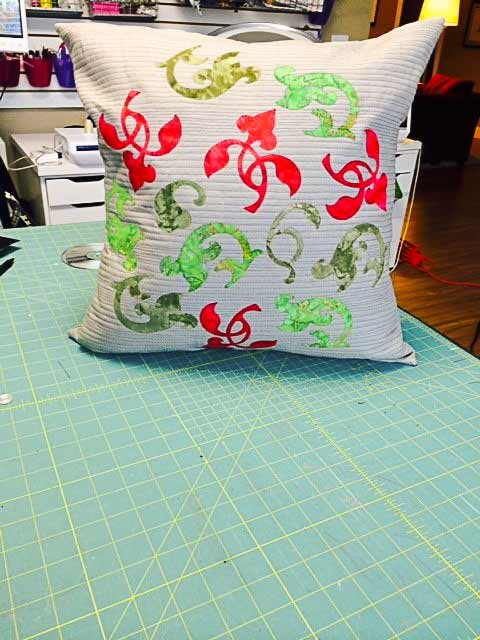 Banish Winter Blahs! Make this cushion for the holidays or to add color to your decor for the long winter ahead. The Brother ScanNCut was used to make the flourish designs! A pattern by Lynn Swanson for A Needle Pulling Thread Winter 2014/15 issue.