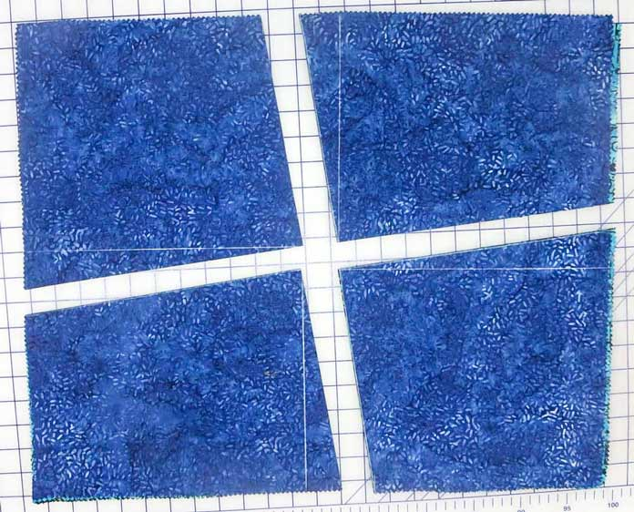 Cut on the diagonal lines through all 4 fabrics.
