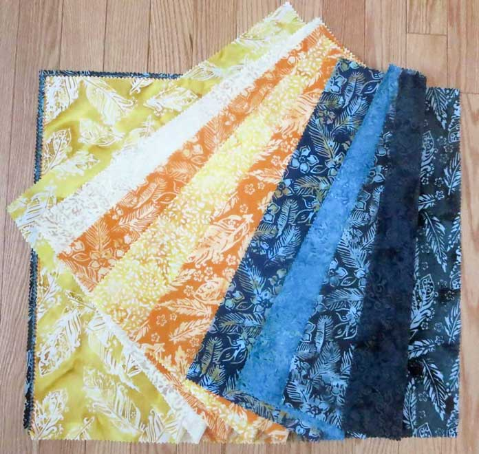 Banyan Batiks Feathers in the mandarin teal colorway