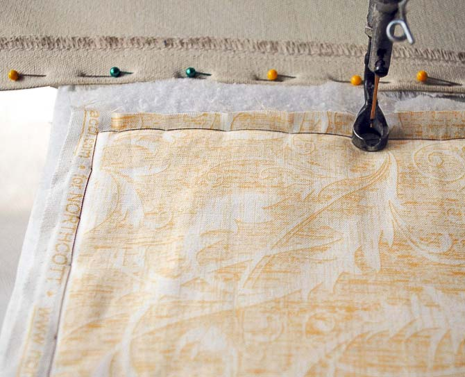 Basting the quilt top on my longarm