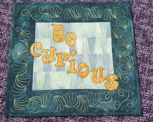 BE CURIOUS quilted wallhanging