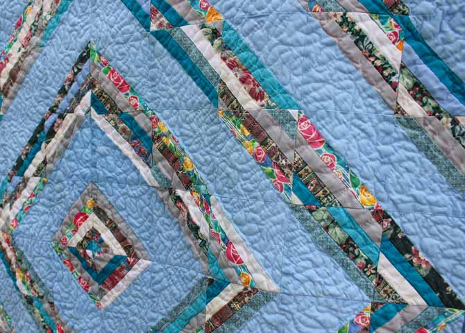 There's some stitch definition in this close look at the very first quilt I quilted with free motion quilting.