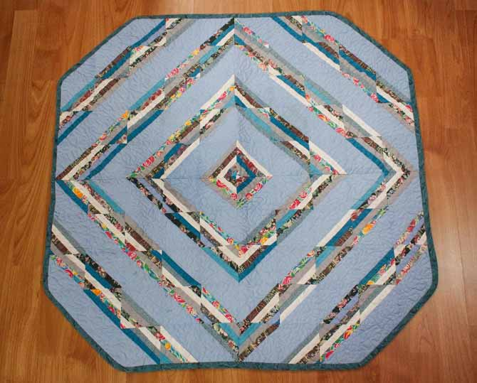 This is the very first quilt I quilted after I learned how to Free Motion Quilt on my domestic sewing machine