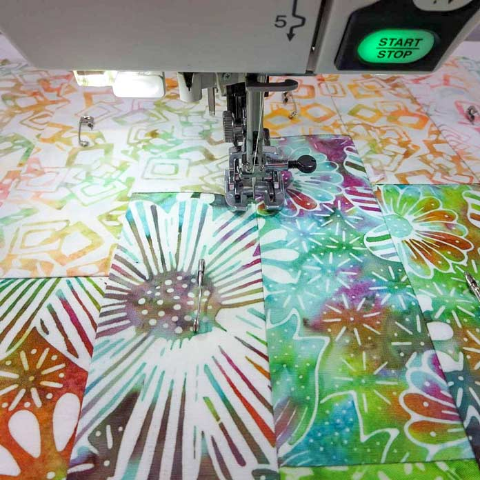 Use a walking foot for machine quilting.