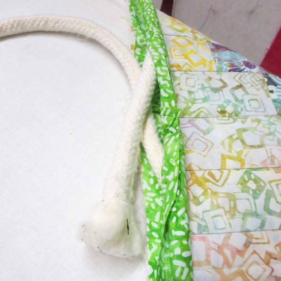 Sew ends of cording fabric together.