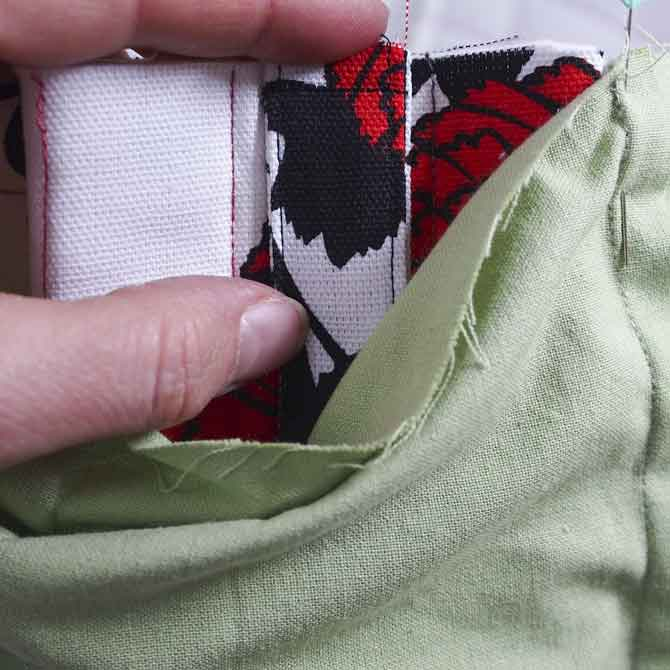 Place fabric loops & clasps between inner & outer bag