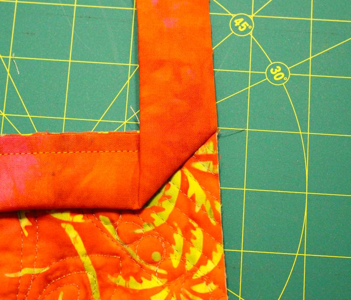 Fold binding strip up and away from the quilt.