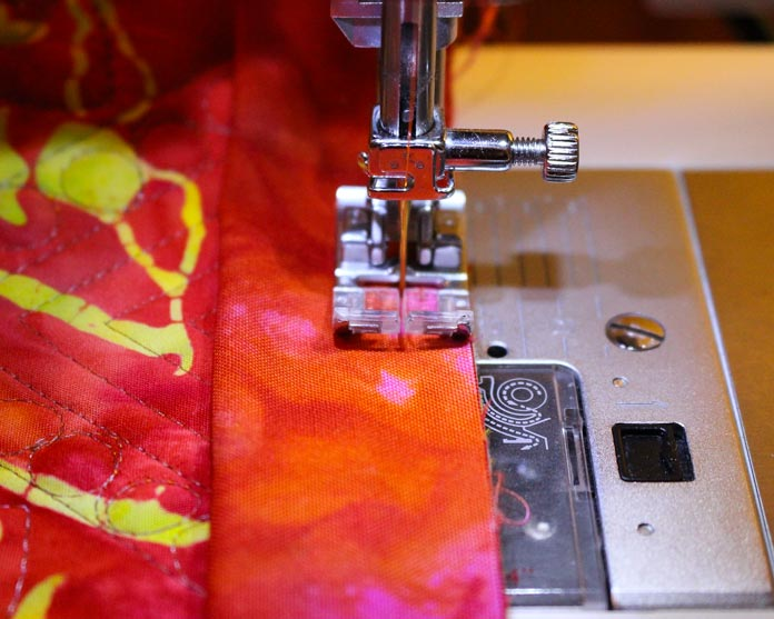 Sew binding to the back of the quilt using the width of a regular sewing foot.