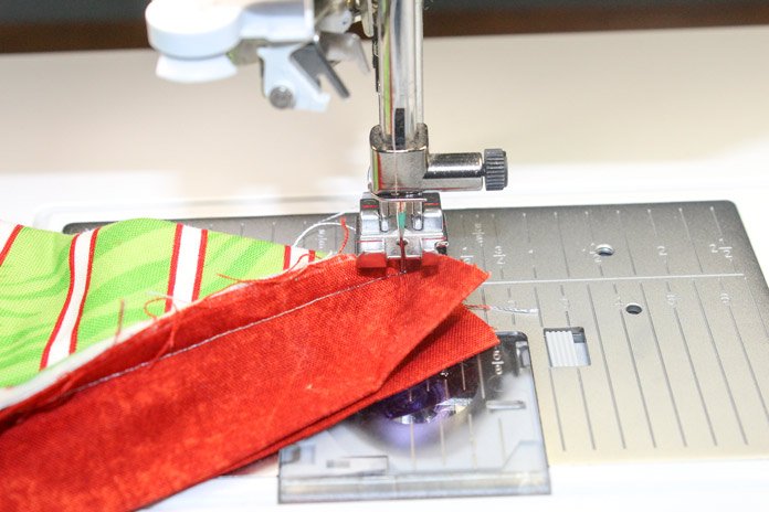"Fold the quilt, right sides together, so that the two strips align perfectly face to face and place needle exactly at the junction of the ¼"" seam allowance."