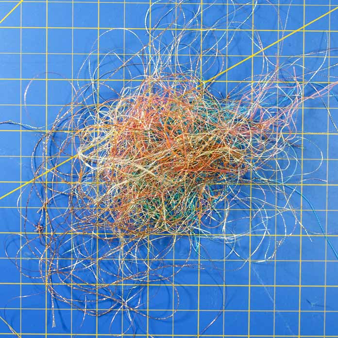 A birds nest of discarded metallic and other threads