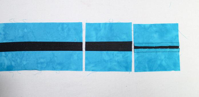 Stitch two L strips along a D strip.