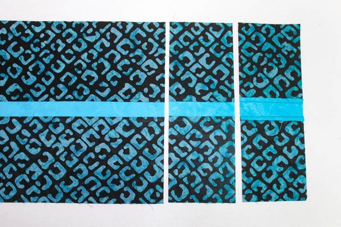 Stitch two H strips along a K strip.