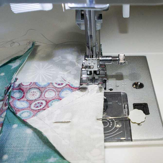 Sewing the border on with the quarter inch foot