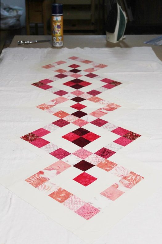 Sandwich your quilt top to the batting and backing