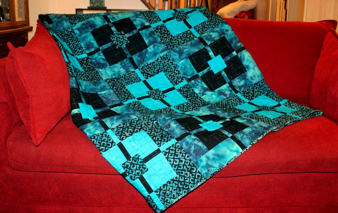 Deep Waters quilt made with Banyan Batiks and Fairfield Bamboo Fil batting
