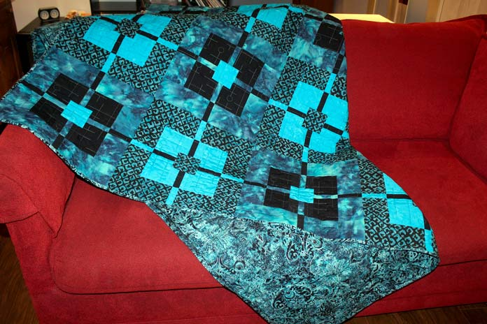 Backing of Deep Waters quilt made with Lustre Turquoise from Banyan Batiks