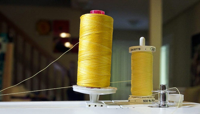 Winding a bobbin from a second spool