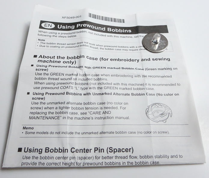 You might need to use the bobbin center pin if you are using pre-wound bobbins.