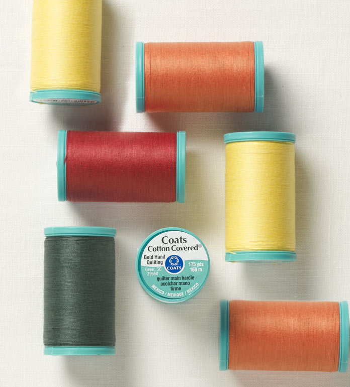Colorful spools of Coats Bold Hand Quilting Thread
