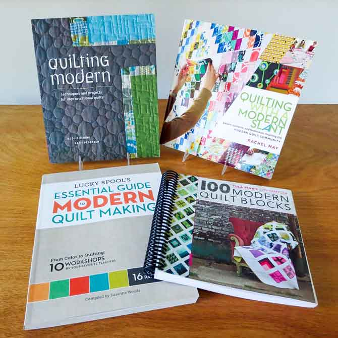 Quilting Modern by Gering and Pedersen, Quilting With a Modern Slant by Rachel May, Lucky Spool's Essential Guide to Modern Quilt Making by Susanne Woods and 100 Modern Quilt Blocks by Tula Pink
