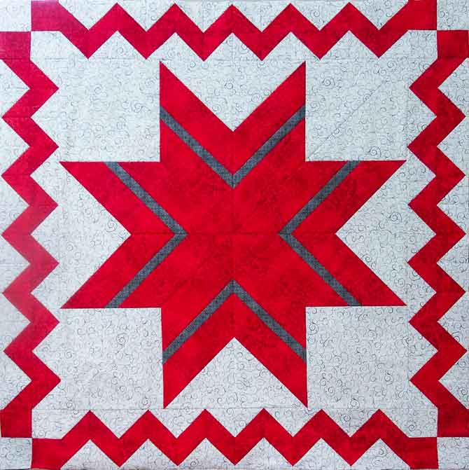 Half square triangle zigzag border around the lone star