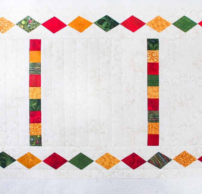 red, green & gold diamonds fused to the border of the runner