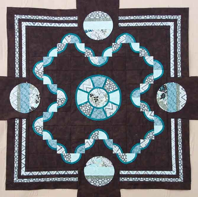 Borders on the quilt - just need to outline the circles in dark teal