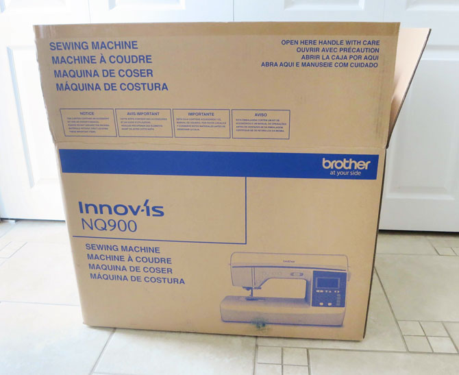 Brother NQ900 sewing machine waiting to be unpacked