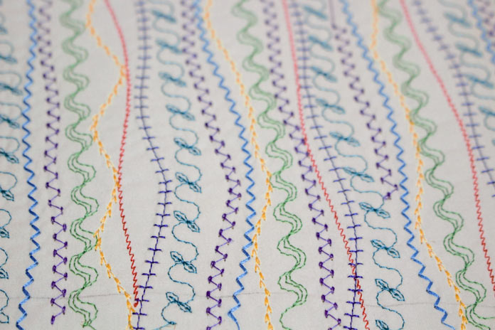 Decorative stitches and WonderFil's rayon threads create one of a kind fabric.