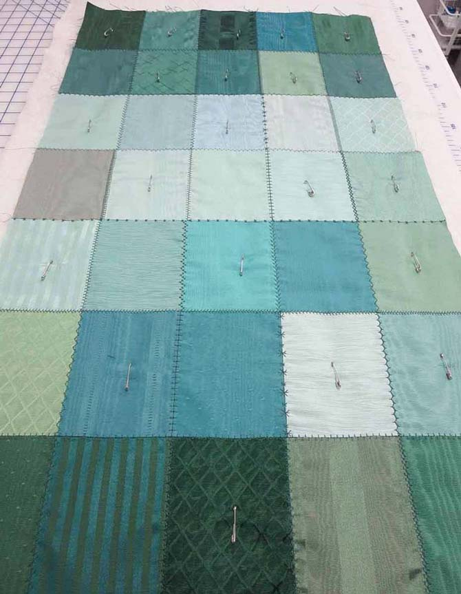 The table runner is pin-basted before quilting with the NQ900 sewing machine.