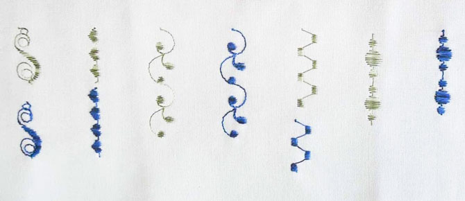 A sampler of a few of the satin stitch designs available on the Brother NQ900, stitched using a variety of threads.
