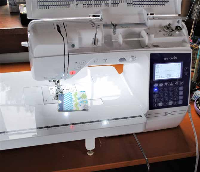 The Brother NQ900 sewing machine is set up and ready to sew.