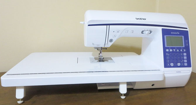 Brother NQ900 sewing machine with wide table attached
