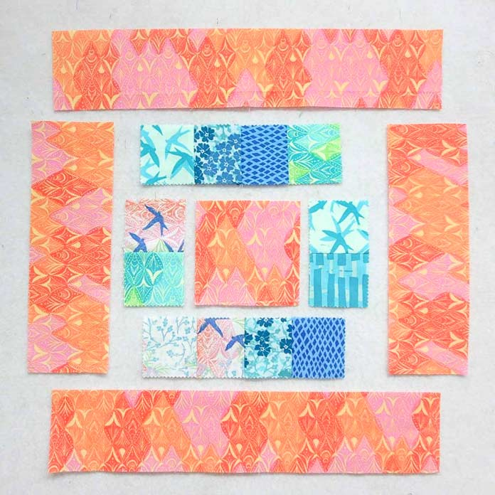 Sew inner borders to center square. Then sew on outer borders.