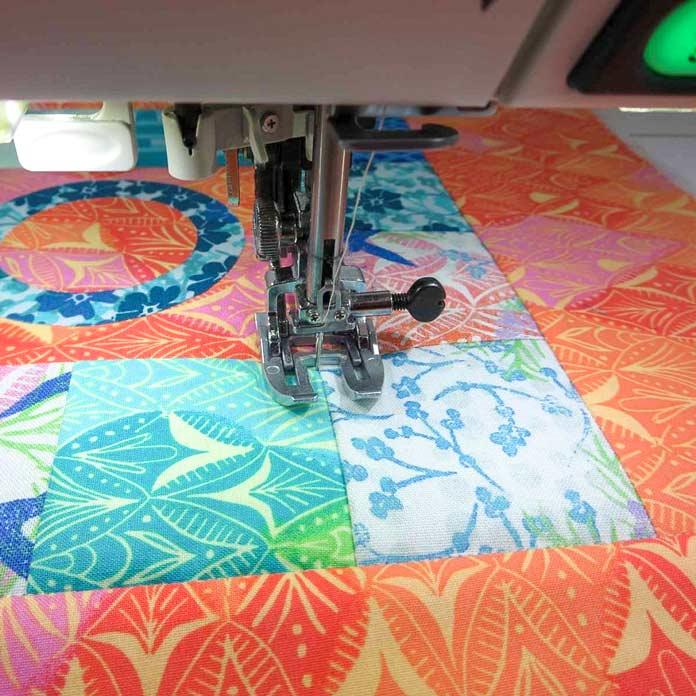 Machine quilt using a walking foot.
