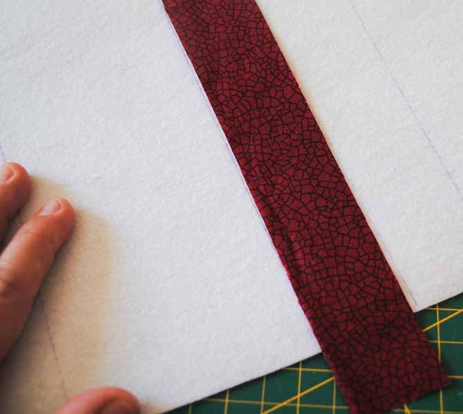 The first fabric strip is placed on the center line of the interfacing.
