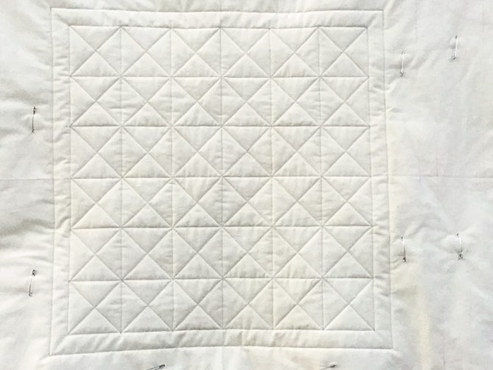 The early steps of wholecloth walking foot quilting tutorial
