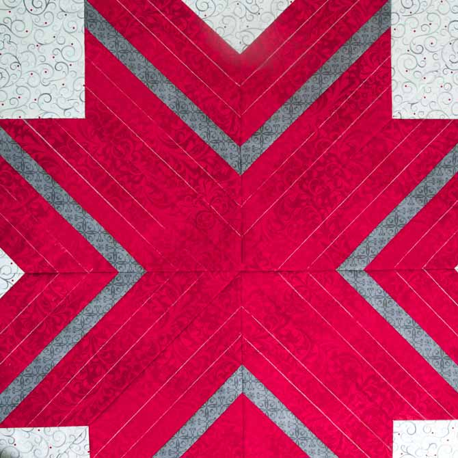 Chalk lines drawn to make out the quilting lines on the lone star