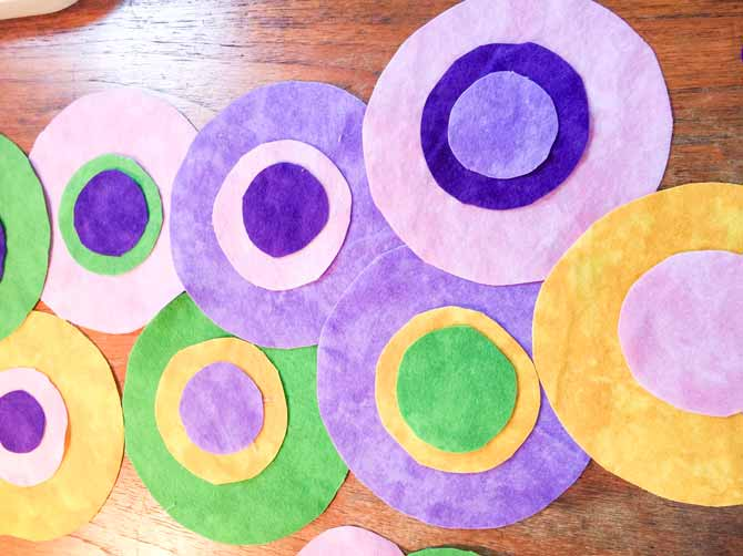 Flannel circles of various sizes stacked on top of each other on a desk.