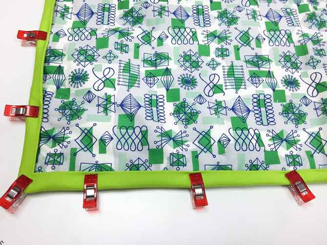 Use Clover Wonder Clips to hold down binding for hand stitching.