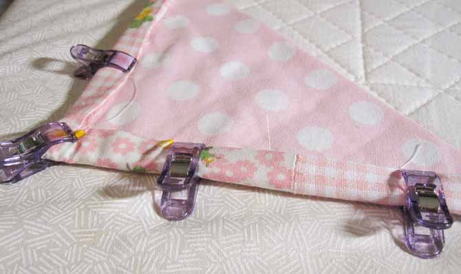 Use small Clever Clips to secure the binding to the back of the quilt, bonus: zero scratches from the pins!