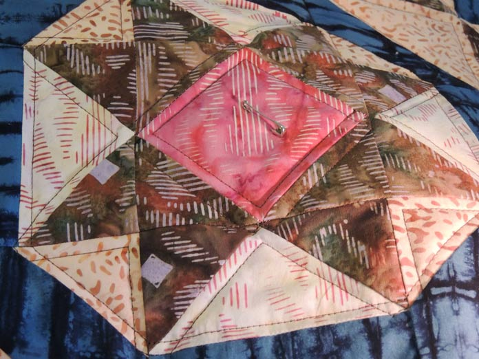Closeup of quilting around pieced design