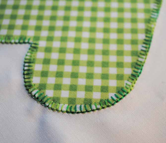 A close up of the Brother NQ900 blanket stitching on the heart applique shape.